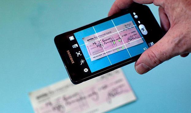 En Argentina el Banco Central reglamentó el depósito electrónico de cheques