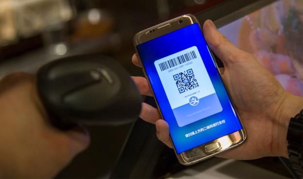 Servicios chinos de pago electrónico móvil impulsan la expansión global